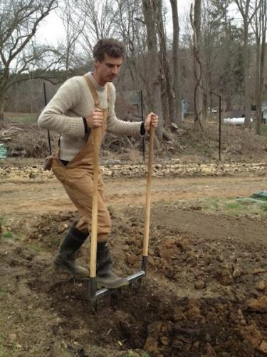 Mike aerating the soil at Purdy's farmer & the fish farm
