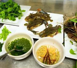 Purdy's Farmer and the Fish, a vinaigrette of puréed grilled ramp leaves, and their pickled stalks, accompanying soft-shell crabs.